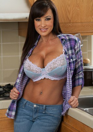 MILF babe with big tits Lisa Ann strips and spreads her cunt