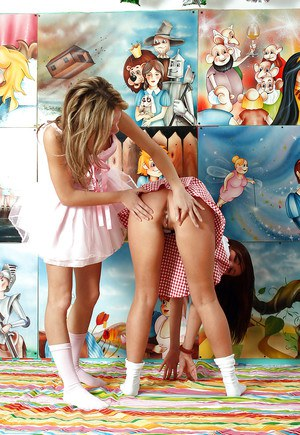 Seductive teen lesbians with sexy legs having fun with their toys