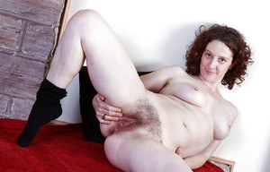 Big titted babe in stockings spreading and teasing her hairy cunt