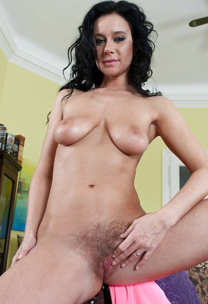 Big titted babe with a hairy cunt fingering her wet clit naked