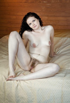 Horny brunette babe stripping and masturbating her shaggy muff