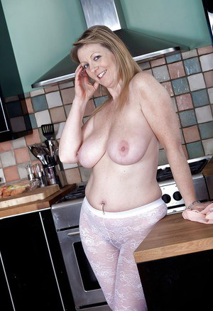 Big busted mature lady with hairy muff Sophie UK stripping off her clothes