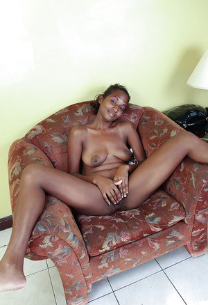 Busty ebony babe taking off her clothes and exposing her shaggy cunt