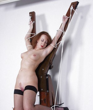 Redhead mature lady with perky tiny tits and trimmed pussy posing bound
