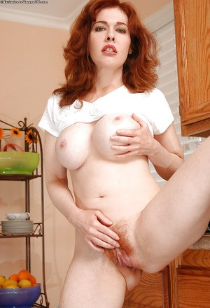 Redhead MILF with big round tits stripping and toying her hairy twat