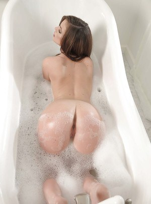 Seductive babe with tiny tits Lily Carter posing naked in the bath