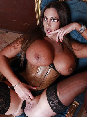 Curvy MILF in glasses Emma Butt slowly stripping off her clothes