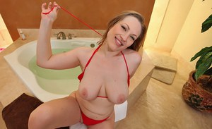 Stunning MILF with ample ass Vicky Vixen uncovering her massive jugs