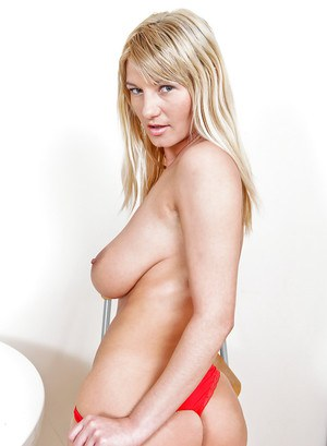 Blonde MILF with big jugs Vanessa Sweets stripping off her clothes