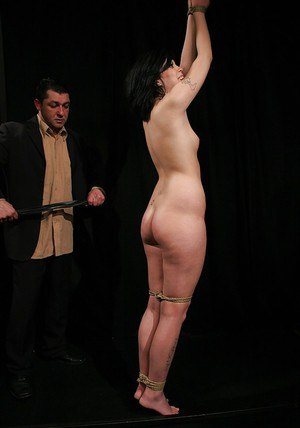 Bound brunette babe with hot ass gets spanked and gives a blowjob