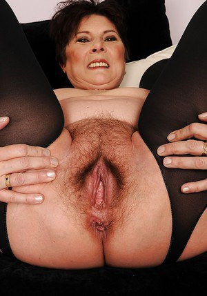Fatty granny in stockings taking off her lingerie and spreading her legs