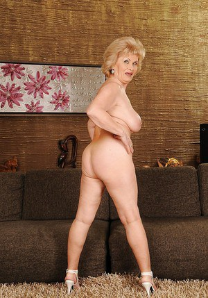 Big busted granny stripping off her dress and posing naked