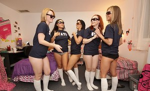 Sexy coeds in sunglasses stripping and having lesbian fun in the dorm room