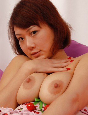Busty asian babe in stockings Kitty Kat stripping and masturbating her muff