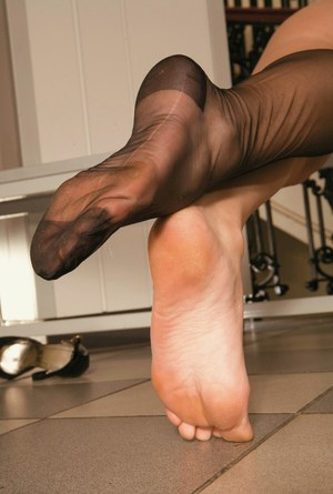 Curvy babe in stockings stripping and making some foot fetish action