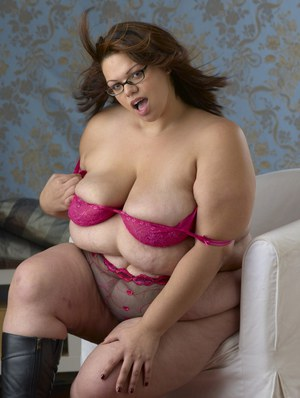 Naughty plumper in glasses Lola Von stripping off her clothes
