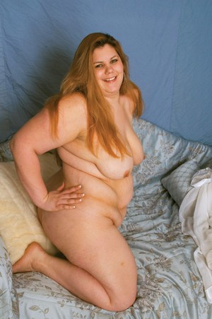 Lusty plumper with big tits posing naked and spreading her legs