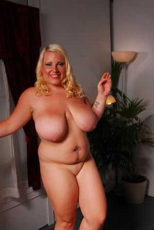 Fatty blonde in glasses smoking and stripping off her clothes