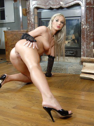 Seductive blonde MILf stripping off her lingerie and spreading her legs