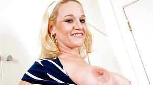 Chubby MILF Dee Siren uncovering her big tits and shaved cunt