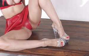 Mature fetish lady showcasing her feet in high heeled shoes and her sexy ass