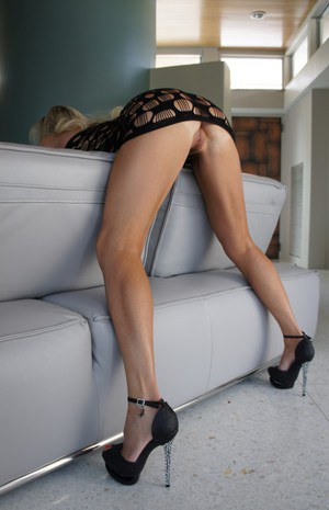 Seductive blonde wife on high heels has no lingerie under her sheer dress