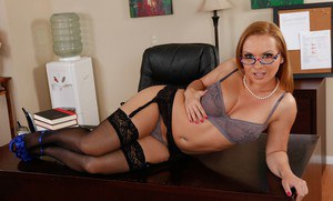 Curvy babe in glasses Katja Kassin stripping and fingering her pussy