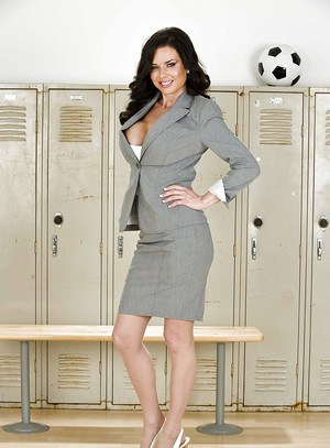 Stunning brunette MILF Veronica Avluv stripping off her suit and lingerie