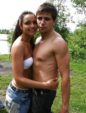 Naughty amateur brunette stripping and kissing with her friend outdoor