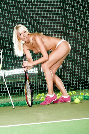 Sporty european blonde stripping off her outfit and lingerie