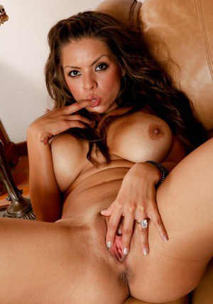 Tattooed latina babe Yurizan Beltran stripping off her clothes