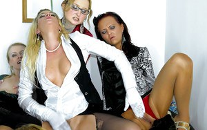 Lascivious pornstar in stockings having lesbian fun with her friends