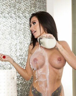 Busty brunette Randi Wright gives a blowjob and gets slammed hardcore