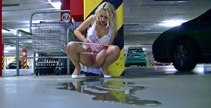 Lustful blonde pornstar doing upskirt and pissing in public place