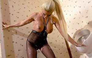 Busty blonde in pantyhose suit Tiffany Six gets bukkaked with fake cum