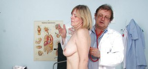 Mature lady with big flabby tits gets her pussy examed by a gyno