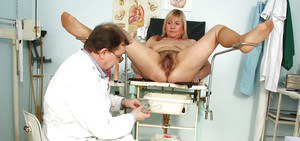 Blonde mature lady gets her wide hairy cunt stretched and toyed by gyno