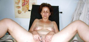 Mature brunette in glasses gets her shaved twat examed by gyno