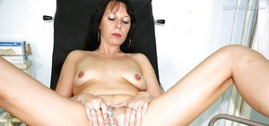 Long haired mature brunette gets her shaved cunt examed by gyno
