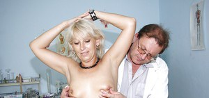 Mature blonde with tiny tits gets her twat examed and toyed by gyno