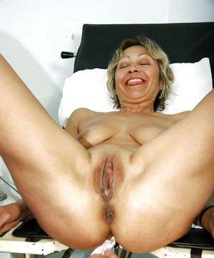 Stunning mature lady with big tits toying her cunt after gyno exam