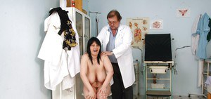 Fatty mature brunette with massive jugs gets her pussy examed by gyno