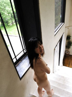 Long haired asian cutie with neat ass and tiny tits posing naked