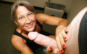 Naughty granny jerking off a big cock and getting a facial cumshot