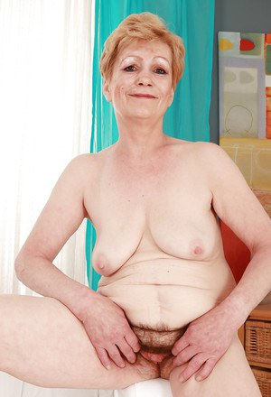 Short haired blonde granny with flabby jugs stripping off her clothes