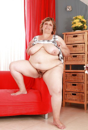 Fatty granny with huge boobs and ass stripping and spreading her legs
