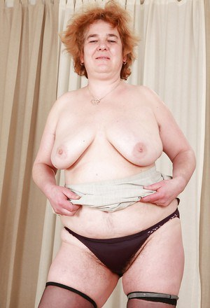 Redhead granny with massive flabby tits exposing her hairy cunt