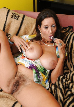 Mature lady Persia Monir uncovering her big tits and hairy pussy