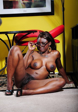 Big busted ebony babe Coco Pink stripping and spreading her legs