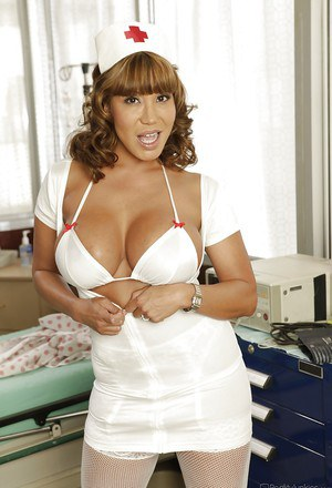 Asian MILF Ava Devine stripping off her nurse uniform and lingerie